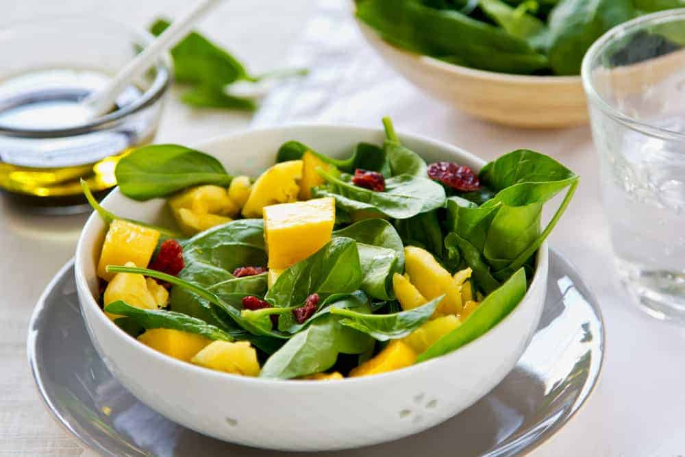 Mango and Pineapple with Spinach and dried cranberries salad