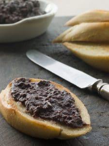 black olive tapenade on bread
