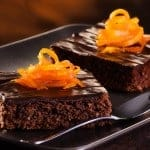 Homemade Chocolate Brownie on a dark plate against a dark background